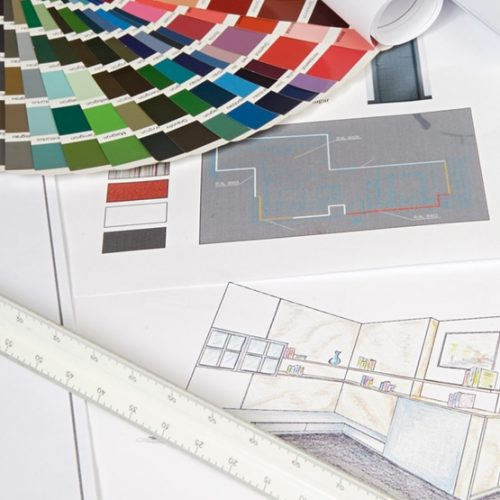 paint chips with design sketches and a ruler